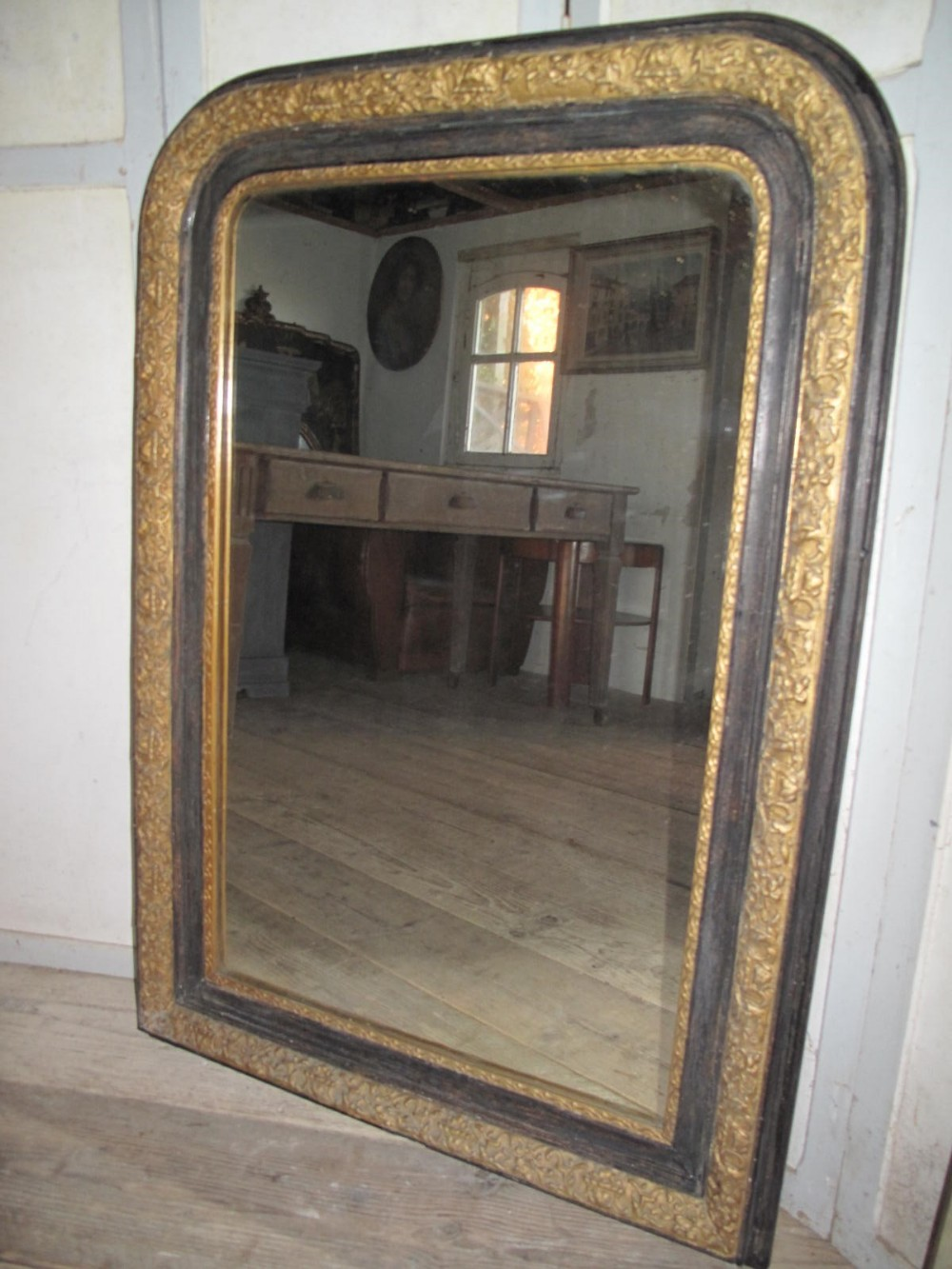 ebonised and gilded french mirror 19thc